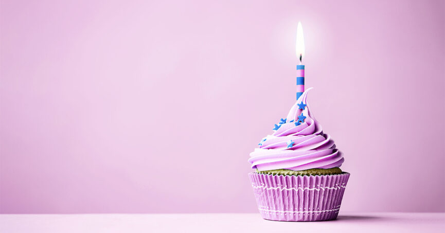 Pink cupcake with a birthday candle