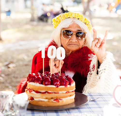 Cool older woman in a park on her 100th birthday