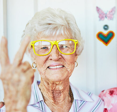 Cool older women making peace signs